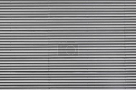 Photo pour Plan large en métal ondulé argenté avec boulons - image libre de droit