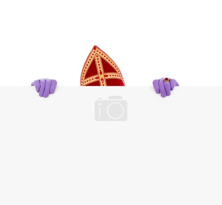 Photo for Sinterklaas or saint Nicholas hiding behind blank cardboard. isolated on white background. Dutch character of Santa Claus - Royalty Free Image