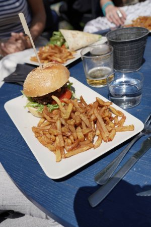 Photo for Closeup of hamburger with french fries - Royalty Free Image