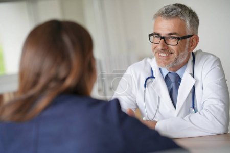 Photo for Doctor with patient in clinic room - Royalty Free Image