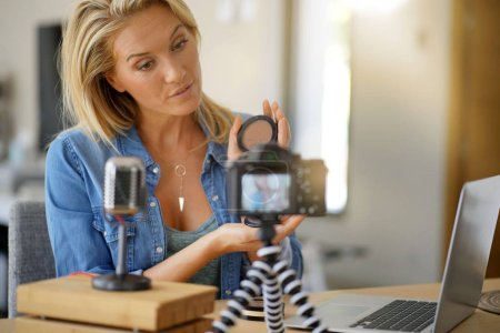 Photo for Vlogger woman recording video for her blog - Royalty Free Image