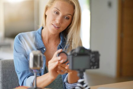 Vlogger woman recording video for her blog