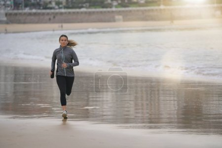A young woman going for an early morning run on th...