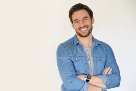 Photo for Very handsome casual man smiling and standing on white background - Royalty Free Image