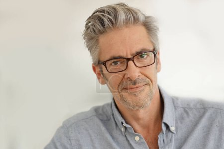 Photo for Portrait of handsome mature man wearing glasses smiling at camera - Royalty Free Image