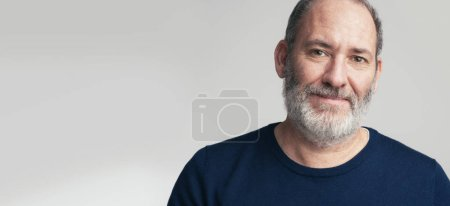 Photo for Portrait of a bearded mature adult casual Businessman looking into camera - Royalty Free Image