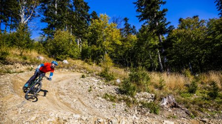 Photo for Mountain biker riding on bike in early spring mountains forest landscape. Man cycling MTB enduro flow trail track. Outdoor sport activity. - Royalty Free Image