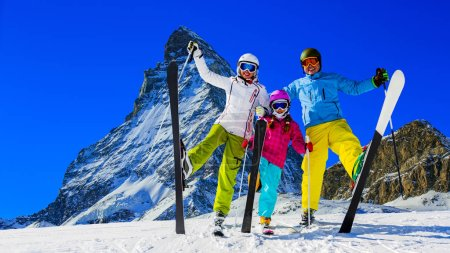 Photo for Happy family enjoying winter vacations in mountains . Ski, Sun, Snow and fun. - Royalty Free Image