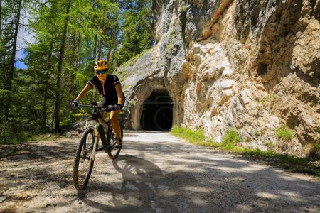 Single mountain bike rider on
