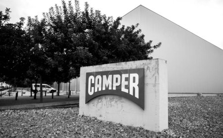 Camper Shoes stone logotype seen from street at the entrance on