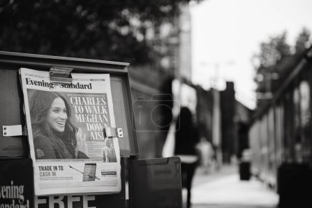 Photo for LONDON, UNITED KINGDOM - MAY 18, 2018: Prince Charles to walk Meghan Markel down aisle - cover of the free newspaper Evening Standard on London street a day before wedding - black and white - Royalty Free Image