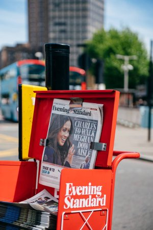 Photo for LONDON, UNITED KINGDOM - MAY 18, 2018: Prince Charles to walk Meghan Markel down aisle - cover of the free newspaper Evening Standard on London street a day before wedding - city bacjground - Royalty Free Image