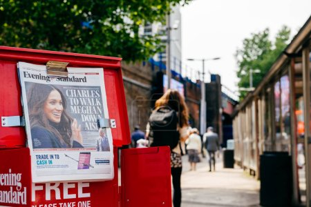Photo for LONDON, UNITED KINGDOM - MAY 18, 2018: Close-up of newspaper cover Prince Charles to walk Meghan Markel down aisle - free media Evening Standard on London street a day before wedding - Royalty Free Image