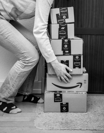 Woman and multiple Amazon Cardboard boxes