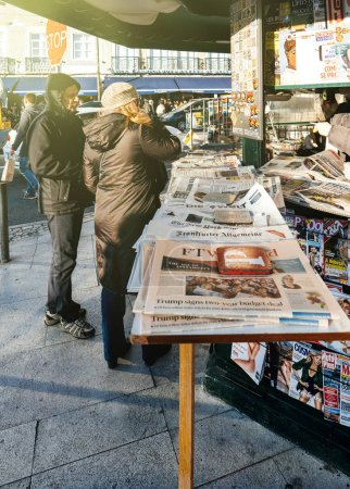 People shopping for international newspapers