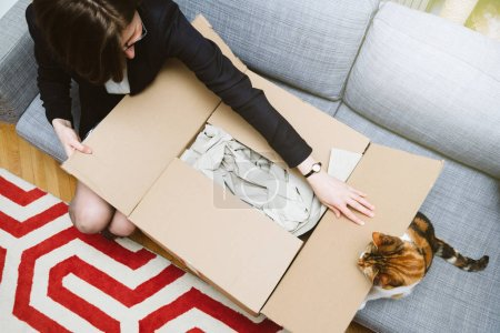 Business woman unpacking unboxing cardboard box box