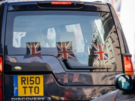 Photo for LONDON, UNITED KINGDOM - MAY 18, 2018: Reflection of Union Jack Flags on Regent Street a day before Royal Wedding between Prince Harry and Meghan Markle will be held at Windsor Castle in Berkshire on May 19, 2018. - Royalty Free Image
