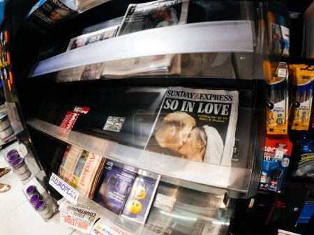 Photo for LONDON, ENGLAND - MAY 20, 2018: Front covers of British national newspapers are seen following the Royal Wedding press kiosk between Prince Harry and Meghan Markle lifestyle event Sunday Express - Royalty Free Image