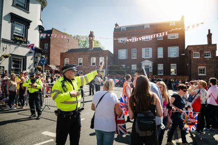 WINDSOR, UNITED KINGDOM - MAY 19, 2018: Met Police officers directing people traffic for royal wedding marriage celebration of Prince Harry, Duke of Sussex and the Duchess of Sussex Meghan Markle