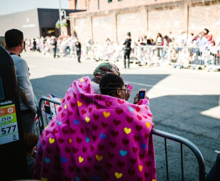 Photo for WINDSOR, BERKSHIRE, UNITED KINGDOM - MAY 19, 2018: Women covered with heart patterned blanket waiting for the royal couple during royal wedding marriage celebration of Prince Harry, and Meghan Markle - Royalty Free Image