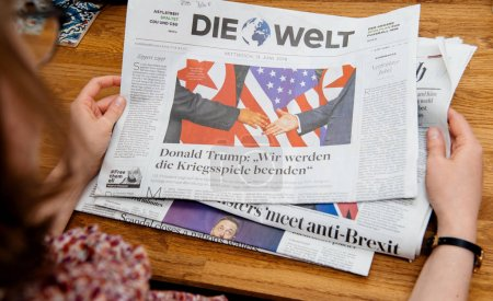 Woman reading about Kim-Trump meeting Die Welt