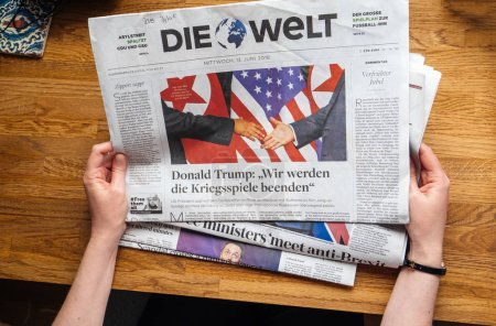 Woman reading about Kim-Trump meeting Die Welt
