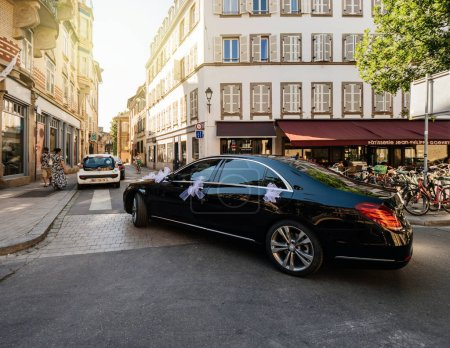 Luxury wedding Mercedes Benz limousine in city