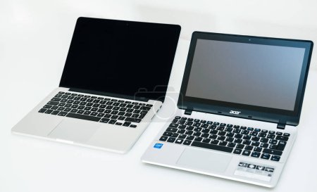 Apple Mac Book pro and Acer Aspire laptop