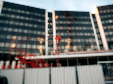 Defocused view of construction site at dusk