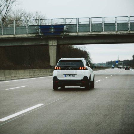 FRANKFURT, GERMANY - FEB 11, 2018: Peugeot 5008 car driving fast on the highway German autobahn