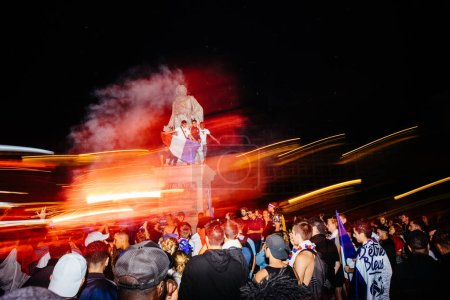 STRASBOURG, FRANCE - JULY 10, 2018: People celebrating happy ambiance on Central Place Kleber after victory of France qualify for final of 2018 FIFA World Cup victory over Belgium 1-0 - lightrails