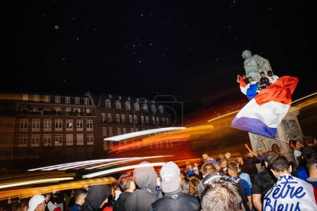 STRASBOURG, FRANCE - JULY 10, 2018: Lightrails over happy ambiance on Central Place Kleber after the victory of France qualify for the final of the 2018 FIFA World Cup after their victory over Belgium