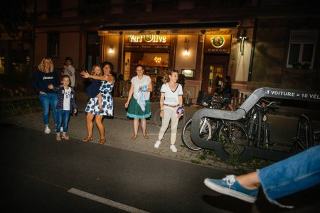 STRASBOURG, FRANCE - JULY 10, 2018: People saluting cyclists French celebration after the victory of France qualify for the final of the 2018 FIFA World Cup after their victory