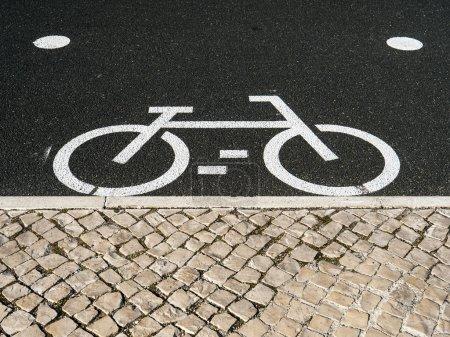 Bicycle white marking on asphalt Lisbon Portugal
