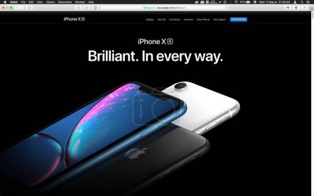 London, United Kingdom - September 12, 2018: Brilliant latest iPhone X R smartphone computer, seen on computer MacBook display after Cupertino keynote product launch