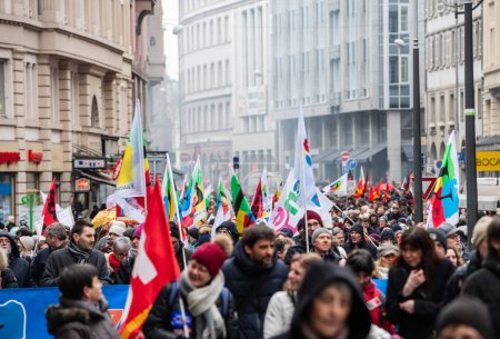Photo for STRASBOURG, FRANCE - MAR 22, 2018: CGT General Confederation of Labour workers with placard at demonstration protest against Macron French government string of reforms - front view of crowd - Royalty Free Image
