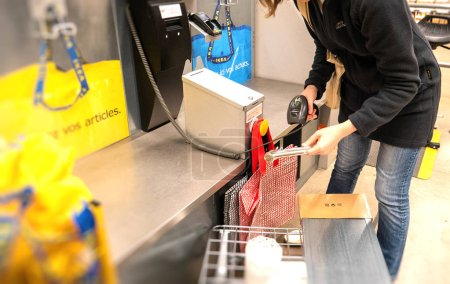 Woman scanning for products at IKEA store shopping