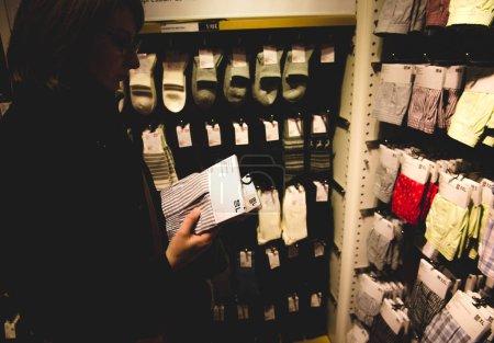Woman buying socks