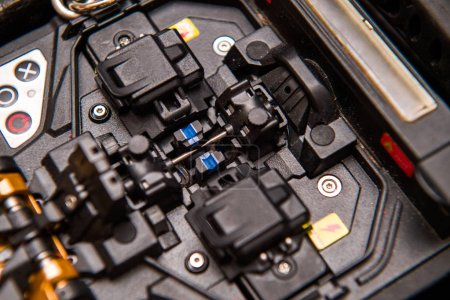 Photo for Macro detail of new modern innovative and powerful performance active clad-alignment splicer used for splicing an array of thin optical fiber types - Royalty Free Image