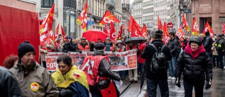 Photo for STRASBOURG, FRANCE - MAR 22, 2018: CGT General Confederation of Labour workers with placard at demonstration protest against Macron French government string of reforms - central street demonstration - Royalty Free Image