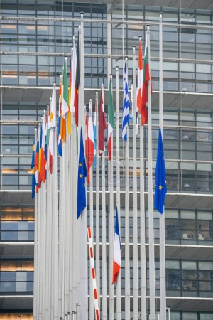 Photo for STRASBOURG, FRANCE - DEC 11, 2018: Vertical image of EU and French Flag flies at half-mast in front of the European Parliament following an attack in center of Strasbourg during annual Christmas - Royalty Free Image