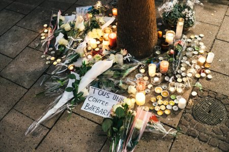 Photo for STRASBOURG, FRANCE - DEC 13, 2018: all united against barbarism message on Rue des Orfevres vigil with multiple light candles flowers and messages for the victims of terrorist Cherif Chekatt at - Royalty Free Image