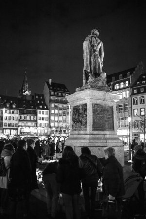 Photo for STRASBOURG, FRANCE - DEC 13, 2018: People mourners gathered near General Kleber statue to attend a vigil with multiple light candles flowers and messages for the victims of terrorist Cherif Chekatt at - Royalty Free Image