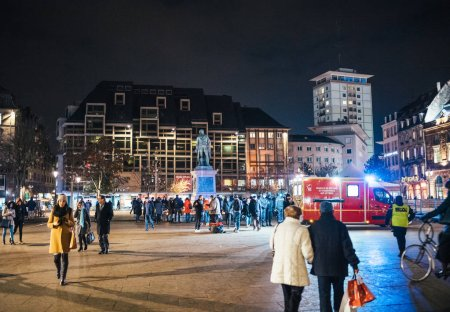 Photo for STRASBOURG, FRANCE - DEC 13, 2018:Large group of people in Strasbourg city center attend a vigil with multiple light candles flowers and messages for the victims of terrorist Cherif Chekatt at - Royalty Free Image