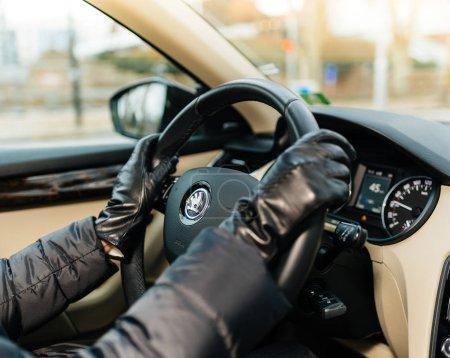 Woman driving inside car wearing