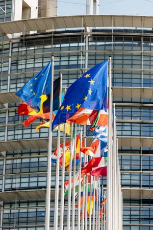 Photo for Flags of all member states of the European Union waving in calm wind in front of the Parliament headquarter on the day of 2019 European Parliament election. - Royalty Free Image