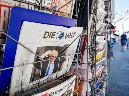 Photo for Paris, France - Jul 24, 2019: Boris Johnson appears on front page of the German Die Welt newspaper after been elected new Conservative leader new Prime Minister of the United Kingdom - city background - Royalty Free Image