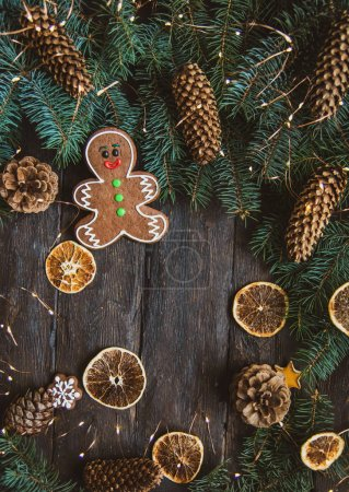 Photo for Gingerbread men laying on wood background. Christmas or New Year composition. copy space. Christmas or New Year composition. Christmas card - Royalty Free Image