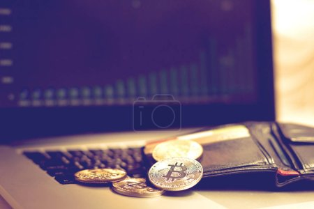 Virtual currency concept, gold coins and printed encrypted money with qr code