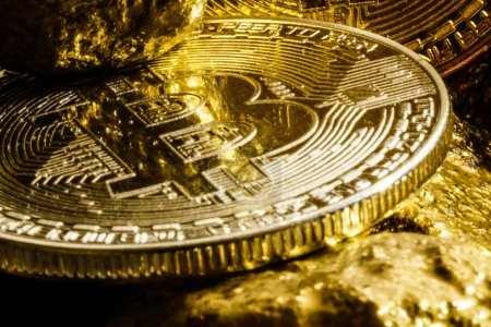 Golden bitcoin and mound of gold bitcoin cryptocurrency business concept